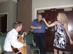 ...so I pulled out my fiddle and I rosined up the bow....Roger on the fiddle, Jim on guitar, and Karen on ....Mr. Microp